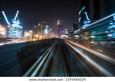 Tran running on rails in a night city., blurred motion with light. #1593466024