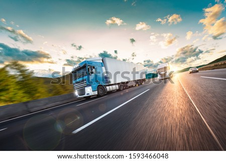 Truck with container on highway, cargo transportation concept. Shaving effect. #1593466048
