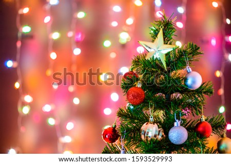 Christmas decoration star and balls Hanging on pine branches christmas tree garland and ornaments with abstract bokeh background with copy space #1593529993