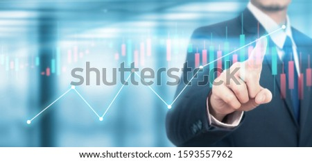 Businessman plan graph growth and increase of chart positive indicators in his business #1593557962