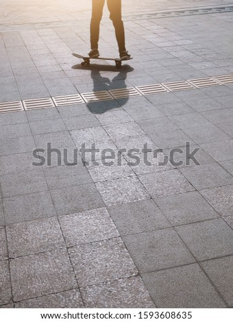Silhouette of skateboarder. shadow of a skateboarder in the morning. Urban style. Black and white photo #1593608635
