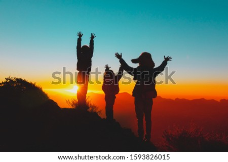 happy father with kids travel in sunset mountains, family hiking in nature #1593826015