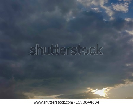Sunrise behind grey clouds. Beautiful abstract background. #1593844834