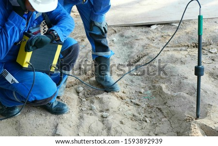 Electricians use electrical leak detector for electrical currents that may have leaks underground at chemical or gas and oil plant.