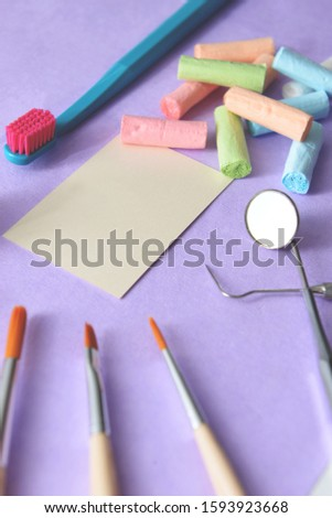 Empty business card with dental tools