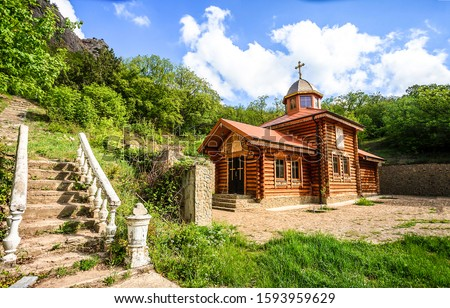 Wooden church in mountains scene. Mountain church view. Wooden church scene. Mountain wooden church #1593959629