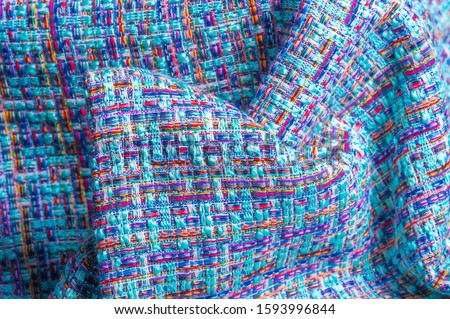 Background texture, pattern. Winter fabric, warm. big braided thread. Blue-red yellow threads. This photo will make your design the best. Wallpapers, pictures, posters. #1593996844
