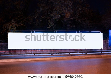 Billboard outdoor, advertising mockup, empty frame copy space for logo and text. Modern flat style signboard. Outdoor street banner night shot, long exposure.