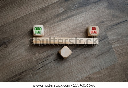 Cubes dice with good deal or no deal on wooden background #1594056568