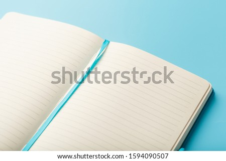 Open notebook, diary with blank and blank pages on a blue background, top view. #1594090507