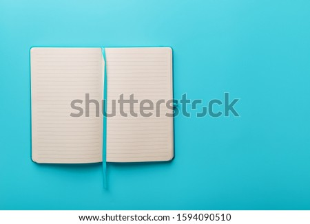 Open notebook, diary with blank and blank pages on a blue background, top view. #1594090510