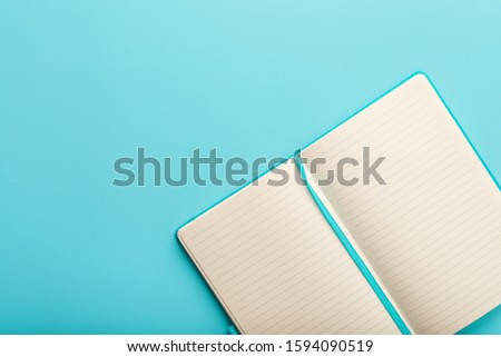 Open notebook, diary with blank and blank pages on a blue background, top view. #1594090519