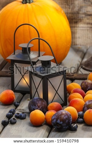 Autumn fruits and traditional lanterns on wooden table. Seasonal decoration. #159410798