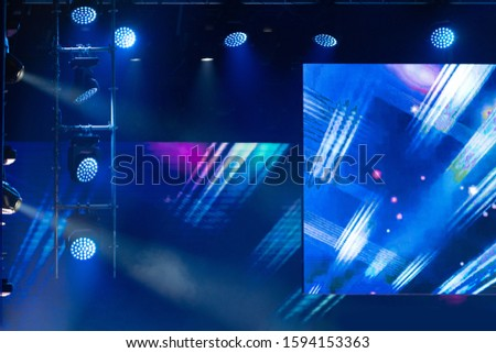 Theater lights spotlights and smoke over the stage, texture background for design. #1594153363