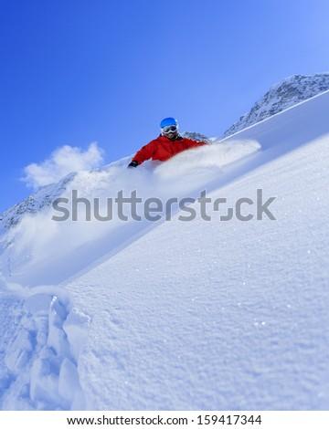 Skiing, Skier, Freeride in fresh powder snow - man skiing downhill #159417344