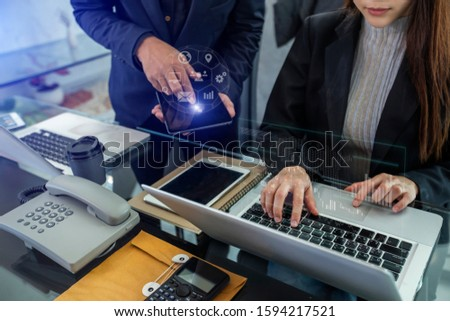 Business teamwork or business partners discussing documents and meeting at the office desk. Global Strategy Virtual Icon.Innovation Graphs Interfaces. Workplace strategy concept. #1594217521