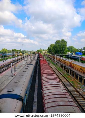 Shots of trains and platform at a railway station #1594380004