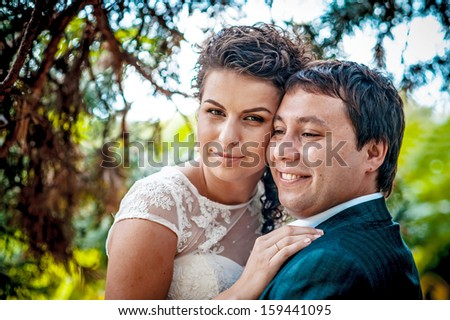 beautiful wedding couple in park. kiss and hug each other  #159441095