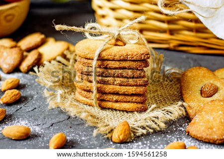 Almond flour cookies. A healthy homemade sugar-free cookie made from almond flour and coconut oil. Proper nutrition, keto baking, sugar-free cookies.Cookies heart with almonds #1594561258
