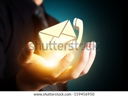 Contact us symbol in businessman hand, Email icon #159456950