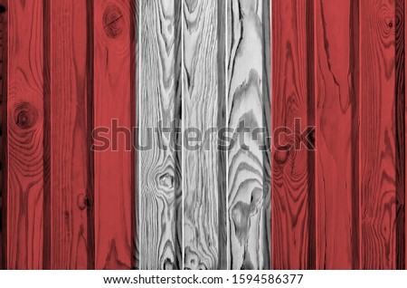 Peru flag depicted in bright paint colors on old wooden wall. Textured banner on rough background #1594586377