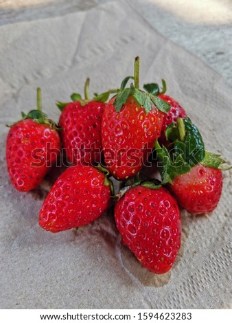 group of riped strawberry on tissue paper #1594623283
