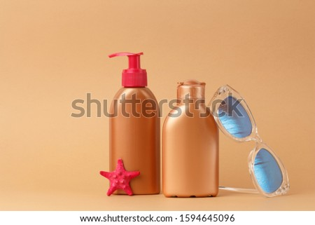 Sunblock ads, sun protection cosmetic products design with moisturizer cream or liquid lotion on bronze, light brown background. Facial and body skin care on the beach, at sea, on summer vacation. #1594645096