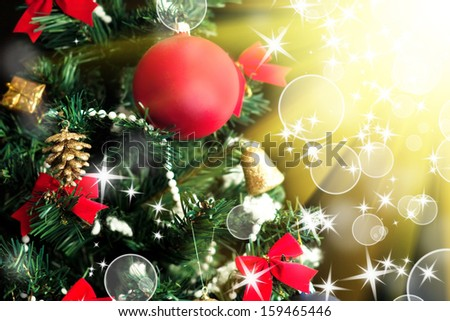 Part of beautiful christmas tree with new year ornaments on black backgrounds. Also is a  free space for your text