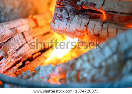 Wood glows in a fireplace #1594720375