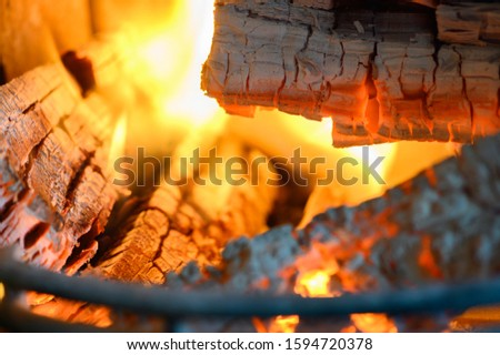 Wood glows in a fireplace #1594720378