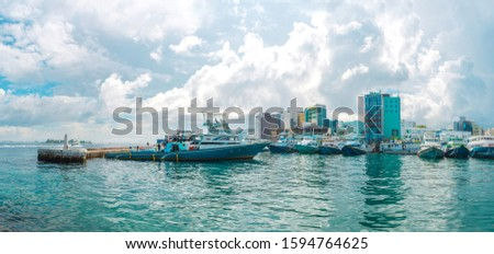 Fishing and transportation Boat in Maldive Harbor beautiful cloudy day and colorful sea in Male Capital place to visit in Maldives #1594764625