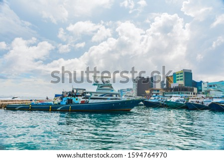 Beautiful Maldive Harbor colorful sea and sky with boats place to visit in Maldives #1594764970