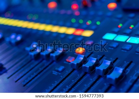 modern electronic mixing console in neon light. selective focus. closeup #1594777393