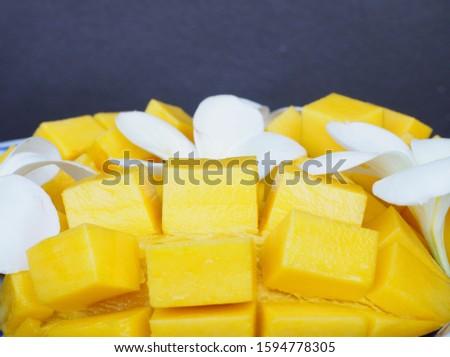 Yellow ripe ripe mango, decorated with white plumeria flowers, Thai fruit, Thai food #1594778305