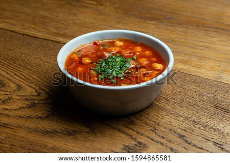 Atabic food called fasolia with red soup #1594865581