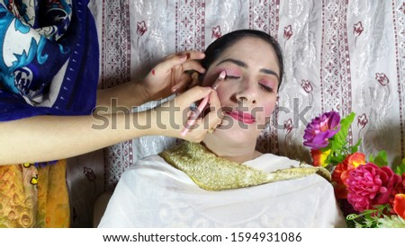 Bridal is getting ready in beauty salon. Stock image of a bride getting ready with makeup. #1594931086