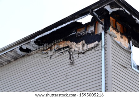 Fire damage to apartment building. #1595005216