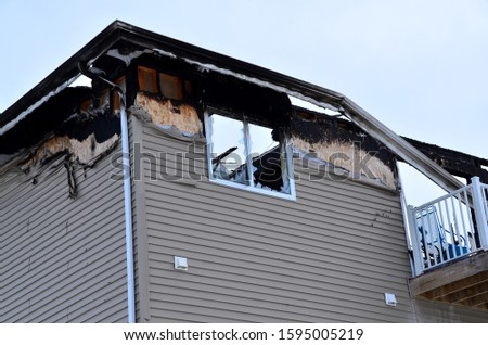 Fire damage to apartment building. #1595005219