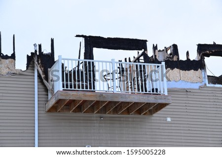 Fire damage to apartment building. #1595005228