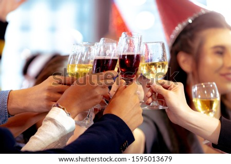 Close up Clinking Glasses of Champagne or Wine. Group of Business People Celebrating New Year at Office party. Friends Happily Organized a celebration Party and Cheers Together at Workplace. #1595013679