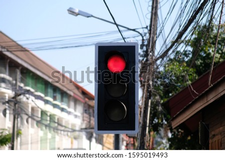 Close up traffic light on the street #1595019493