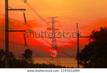silhouette electricity pole, electricity pylons technology on sunset time background #1595022889