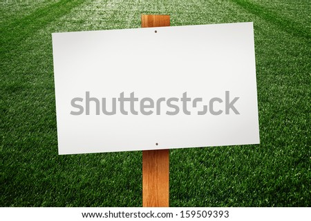 Blank sign on green lawn for your message.