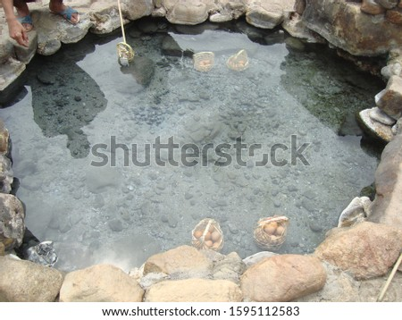 eggs in bamboo basket boiling in hot spring water, mineral water  #1595112583