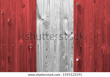 Peru flag depicted in bright paint colors on old wooden wall. Textured banner on rough background #1595123191