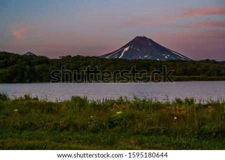 Panoramic view of the city Petropavlovsk-Kamchatsky and volcanoes: Koryaksky Volcano, Avacha Volcano, Kozelsky Volcano. Russian Far East, Kamchatka Peninsula. #1595180644