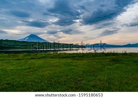 Panoramic view of the city Petropavlovsk-Kamchatsky and volcanoes: Koryaksky Volcano, Avacha Volcano, Kozelsky Volcano. Russian Far East, Kamchatka Peninsula. #1595180653
