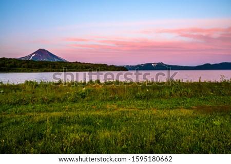 Panoramic view of the city Petropavlovsk-Kamchatsky and volcanoes: Koryaksky Volcano, Avacha Volcano, Kozelsky Volcano. Russian Far East, Kamchatka Peninsula. #1595180662