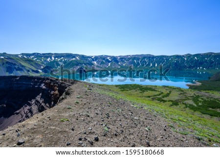 Panoramic view of the city Petropavlovsk-Kamchatsky and volcanoes: Koryaksky Volcano, Avacha Volcano, Kozelsky Volcano. Russian Far East, Kamchatka Peninsula. #1595180668