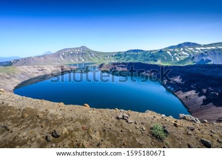 Panoramic view of the city Petropavlovsk-Kamchatsky and volcanoes: Koryaksky Volcano, Avacha Volcano, Kozelsky Volcano. Russian Far East, Kamchatka Peninsula. #1595180671